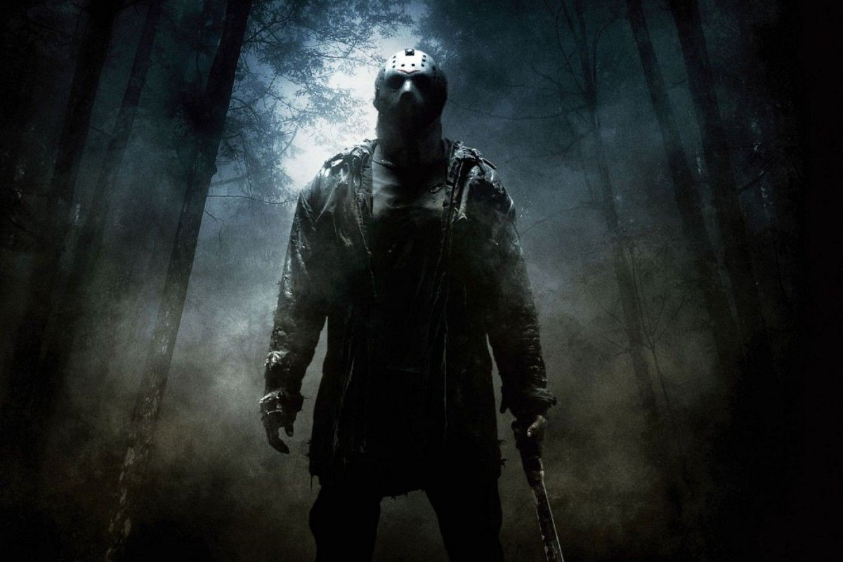 Friday the 13th Jason stands in the middle of the woods