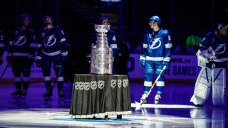 The Tampa Bay Lightning with the Stanley Cup, after raising the banner on Jan. 13. The Lightning won the 2020 Stanley Cup.