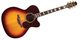 Country star's new electro-acoustic features his own silhouette on the headstock