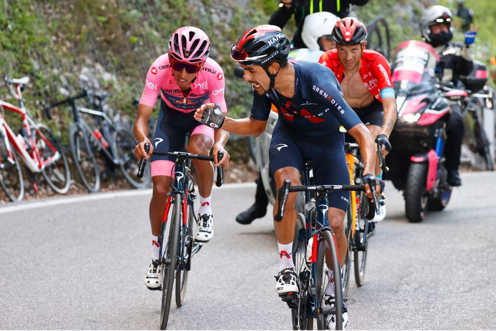 TOPSHOT Team Ineos rider Colombias Daniel Martinez Front encourages his teammate overall leader Team Ineos rider Colombias Egan Bernal L as they ride along with Team Bahrain rider Italys Damiano Caruso Rear R in the last ascent during the 17th stage of the Giro dItalia 2021 cycling race 193km between Canazei and Sega di Ala on May 26 2021 Photo by Luca Bettini POOL AFP Photo by LUCA BETTINIPOOLAFP via Getty Images