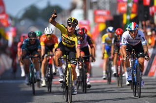 FLEURUS BELGIUM JULY 23 Dylan Groenewegen of Netherlands and Team Jumbo Visma celebrates at arrival ahead of Giacomo Nizzolo of Italy and Team Qhubeka Nexthash during the 42nd Tour de Wallonie 2021 Stage 4 206km stage from Neufchteau to Fleurus tourdewallonie grandprixdewallonie on July 23 2021 in Fleurus Belgium Photo by Luc ClaessenGetty Images