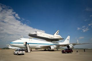 The space shuttle Enterprise is seen mated on top of the NASA's Shuttle Carrier Aircraft (SCA), a modified Boeing 747 jumbo jet, at Washington Dulles International Airport on Saturday, April 21, 2012.