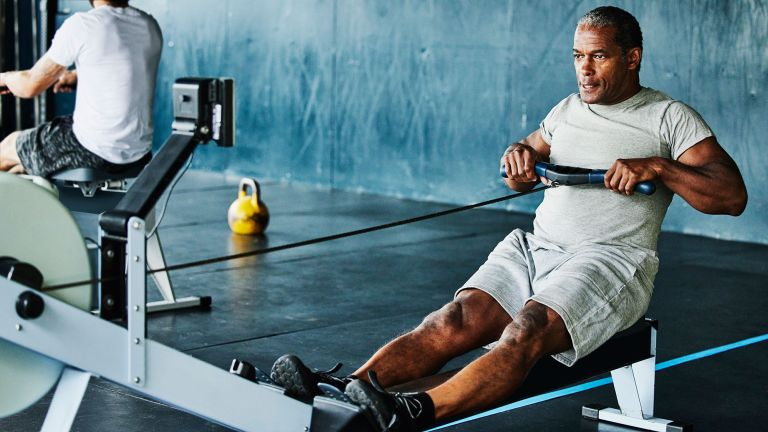 A man working out on a rowing machine