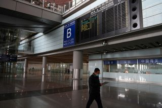 A nearly empty international arrivals area at Beijing airport on November 6, 2020.