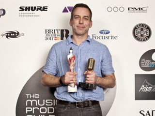 Markus Dravs clutches his MPG and Brit Awards.