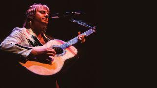 Greg Lake playing guitar