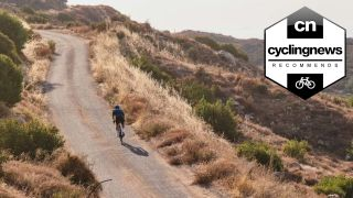 Cyclist riding one of the best endurance road bikes through a desert road