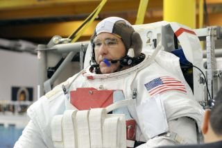 Discovery shuttle astronaut Steven Bowen trains for the two spacewalks of NASA's STS-133 mission to the International Space Station before flight.