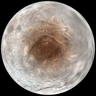Pluto's largest moon Charon has a red spot at its north pole that may be caused by the atmosphere of Pluto, scientists announced on Sept. 14, 2016. This view shows a view looking down on Charon's red spot as seen by NASA's New Horizons spacecraft during i