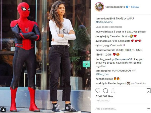 Spider-Man and Michelle standing together with arms crossed