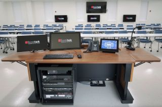 Rack-mounted within the instructor lectern located in each active learning and traditional classroom is the AV system. It includes NAV E 101 encoders and NAV SD 101 scaling decoders. Additional scaling decoders are mounted to the two projector lifts.