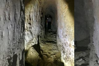 Seven inscriptions were found in looters' tunnels dug beneath the destroyed tomb of Jonah (one of the tunnels is shown here).