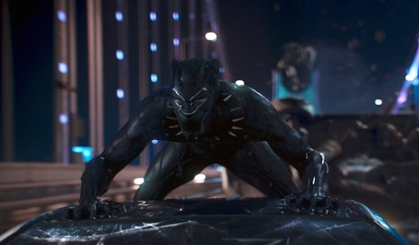 Black Panther T'challa in costume on top of a car