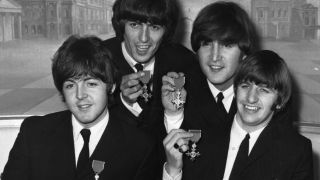 The Beatles with their MBEs in 1965
