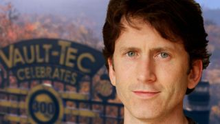 Bethesda Game Studios' Todd Howard in front of a blurry image of Fallout 76.