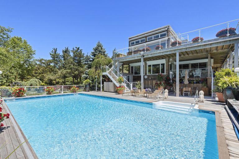 house and swimming pool in Long Island