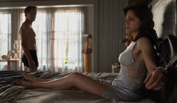 Gerald's Game Bruce Greenwood looks at Carla Gugino, handcuffed to the bed