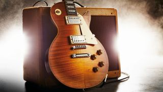 Gibson Les Paul electric guitar resting on Fender Deluxe tweed guitar amp