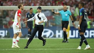 Russian punks Pussy Riot are charged by authorities after they invaded the pitch during yesterday's football World Cup final