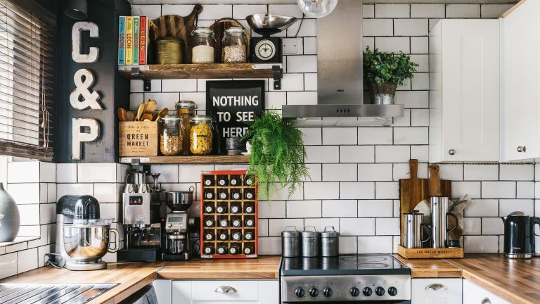 budget kitchen makeover with white metro tiles, wooden worktops and industrial open shelving