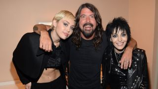 Dave Grohl with Joan Jett and Miley Cyrus at the Rock and Roll Hall Of Fame