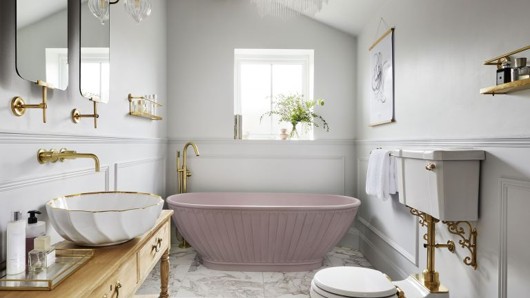 pink freestanding bath in a traditional bathroom
