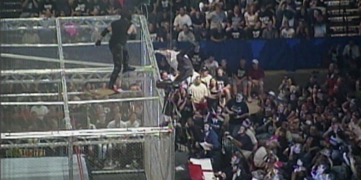 The Undertaker throwing Mankind off the cell at King of the Ring 1998