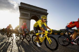 Egan Bernal rides on the Champs Elysees at the 2019 Tour de France