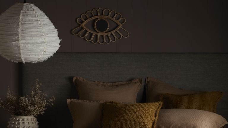 Abigail Ahern colors that will make a room look bigger, brown interiors in a dark bedroom