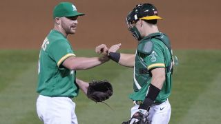 Liam Hendriks #16 and Sean Murphy #12, Oakland Athletics