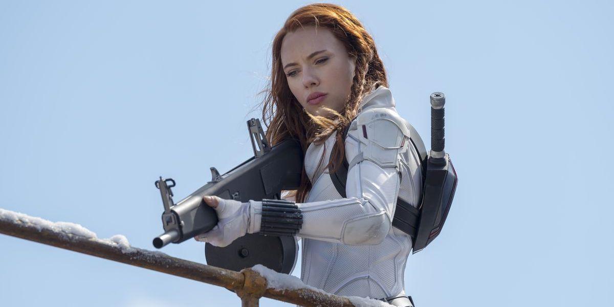 Scarlett Johansson pointing a gun in Black Widow white suit