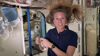 NASA astronaut Karen Nyberg demonstrates how a single strand of hair can be used to move in the microgravity environment of space in a video recorded on the International Space Station in October 2013.