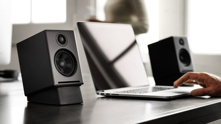 The best computer speakers hero image showing the Audioengine A2+ being used with a laptop on a desk