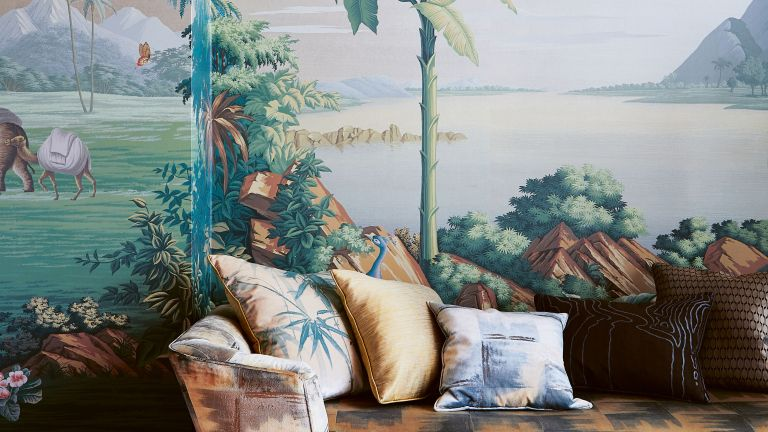 Tropical wall mural behind a colorful sofa with pillows