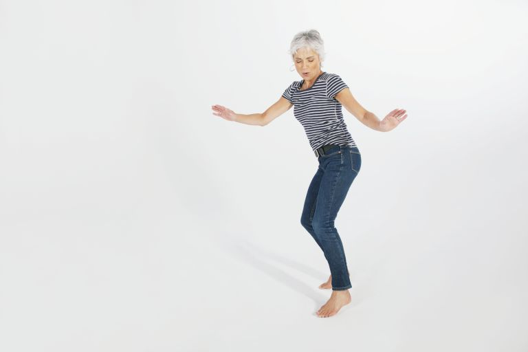 woman dancing in a white background