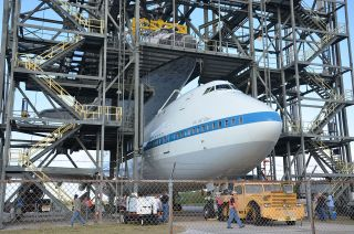 Space shuttle Discovery was mated atop NASA's Shuttle Carrier Aircraft, a modified Boeing 747, on Sunday, April 15, 2012 for the spacecraft's upcoming ferry flight to the Smithsonian.