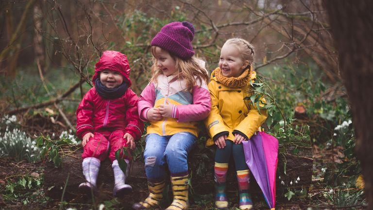 garden activities for kids: three girls wearing squelch wellies