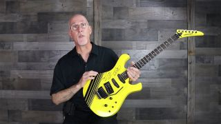 Tom Weber holding a Yellow Kramer Paul Dean signature gifted to him by Eddie Van Halen