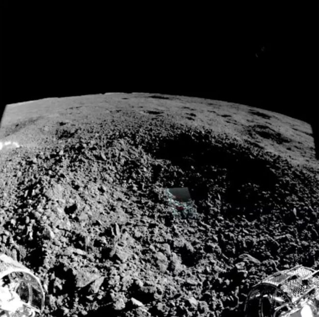 China's Yutu-2 moon rover captured this image from the edge of the small crater where it found a mysterious, gel-like material.