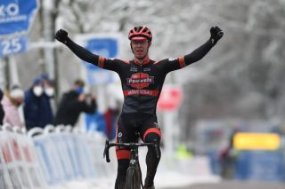 Belgian Laurens Sweeck celebrates as he crosses the finish line of the mens elite race of the Krawatencross cyclocross in Lille the seventh stage out of 8 in the X2O Trofee Veldrijden competition Sunday 07 February 2021BELGA PHOTO DAVID STOCKMAN Photo by DAVID STOCKMANBELGA MAGAFP via Getty Images