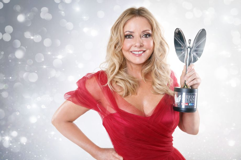 Smiling Carol Vorderman with the Pride of Britain award