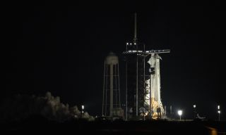 A SpaceX Falcon 9 rocket test fires its nine first-stage engines atop Launch Pad 39A of NASA's Kennedy Space Center in Cape Canaveral, Florida on April 17, 2021. The rocket will launch NASA's Crew-2 astronaut mission for NASA on April 22.