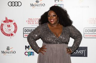 Judi Love on the red carpet in 2019 wearing a sparkly dress