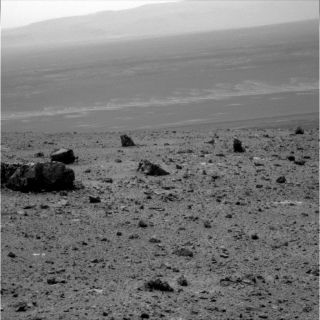 NASA's Mars Exploration Rover Opportunity used its panoramic camera to capture this raw vista looking across Endeavour crater during the rover's 2,686th Martian day, or sol, of work on Mars (Aug. 14, 2011). This photo was taken three days after Opportunit