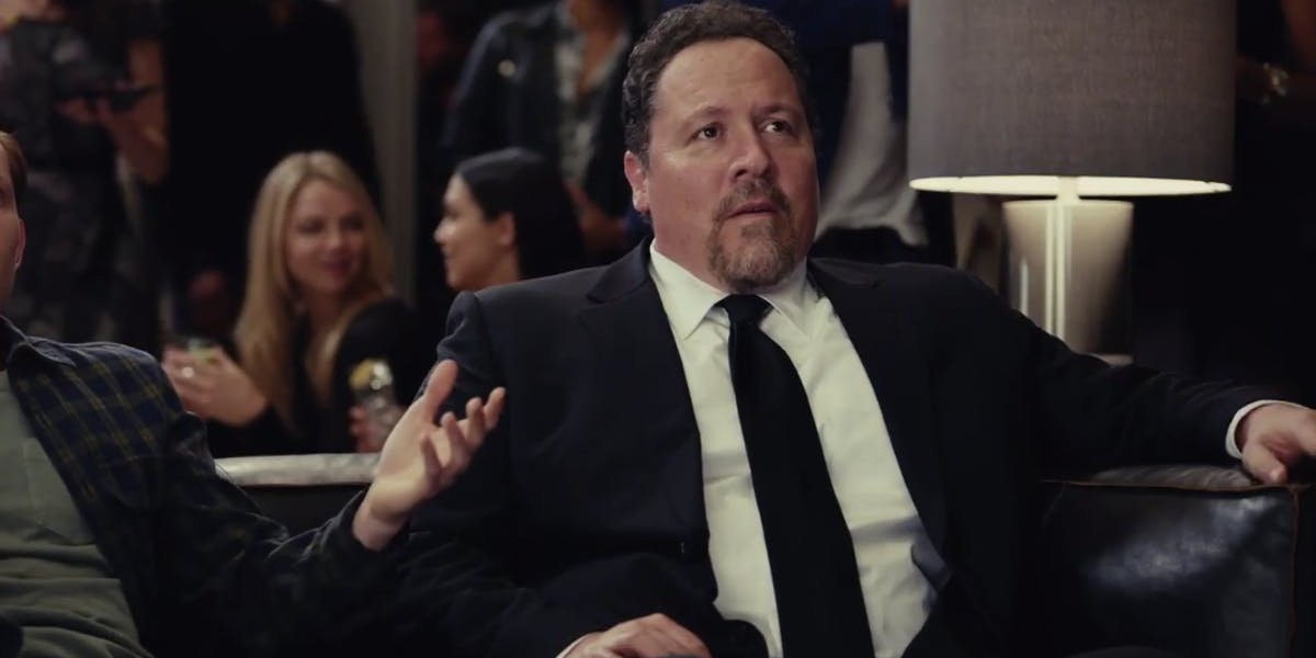 Spider-Man: Far From Home Happy Hogan sits on a couch, with a slight look of disbelief