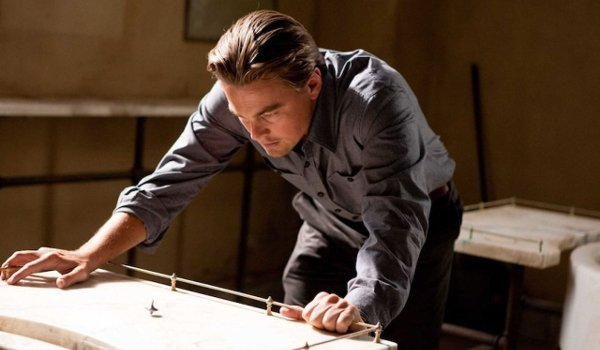 Inception Leonardo DiCaprio Dom stares at his top