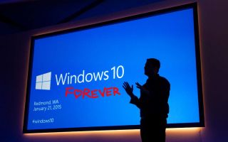 Windows 10 launch event screen with shadow of presenter in front of it