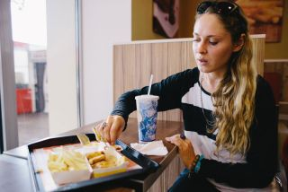 A young women with fast food