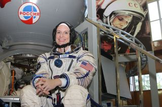 Astronaut Kate Rubins with Yuri Gargarin photo