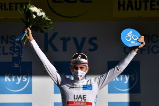 Team UAE Emirates rider Slovenias Tadej Pogacar celebrates his best youths white jersey on the podium after the 4th stage of the 107th edition of the Tour de France cycling race 157 km between Sisteron and OrcieresMerlette on September 1 2020 Photo by AnneChristine POUJOULAT AFP Photo by ANNECHRISTINE POUJOULATAFP via Getty Images
